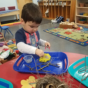 Child learning indoors at Toddle Inn