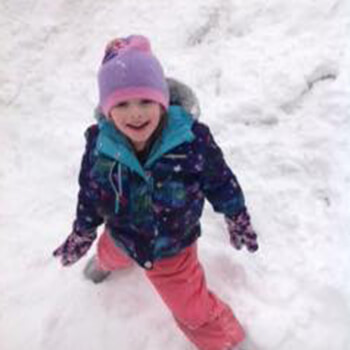 Kindergarten child playing in snow at Toddle Inn