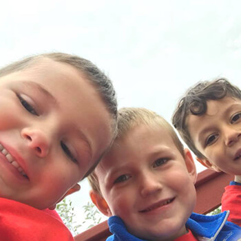 Kids taking selfies with smiles at Toddle Inn