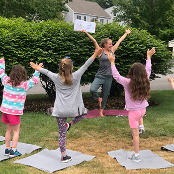 Learning yoga at Toddle Inn