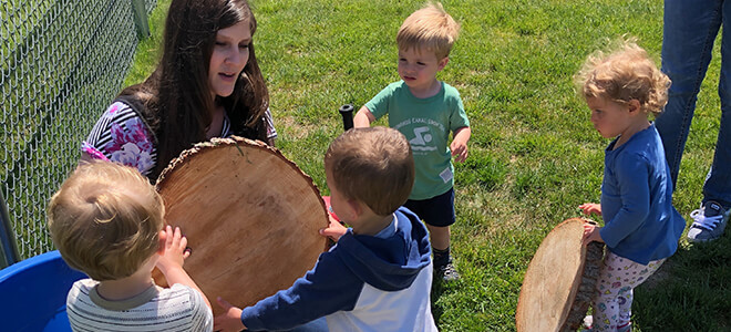 Toddlers learning about wood slices